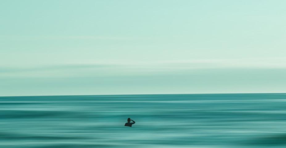 Tiny figure lost at sea