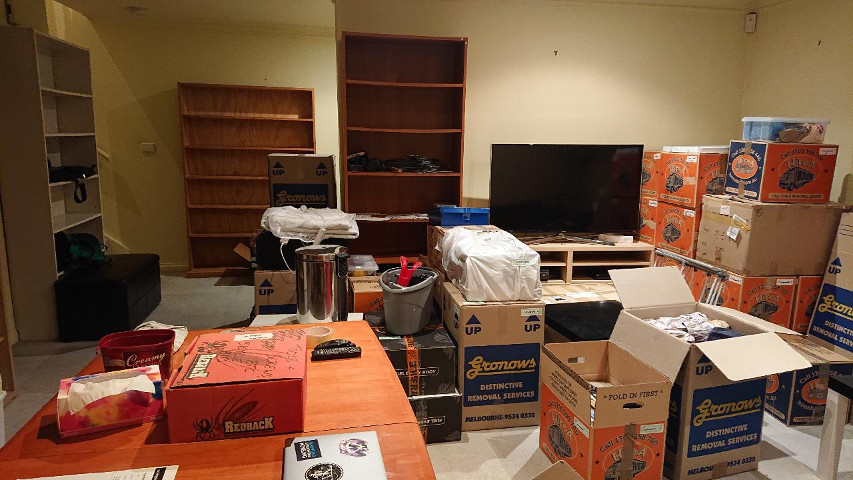 Empty furniture and full moving boxes