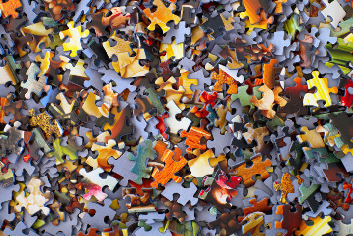 A mess of jigsaw puzzle pieces