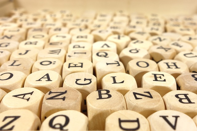 A jubmle of letters on wooden cubes